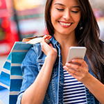 Woman-texting-while-shopping_thumbnail