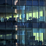 Workplaces-behind-clear-windows-in-financial-building_thumbnail